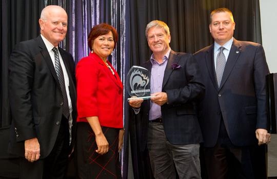 Doug Webber, founder of Webber's Lodges, receives Winnipeg Airport Authority Award of Distinction from Travel Manitoba