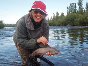 Nina with first arctic grayling at North Knife lake Lodge.